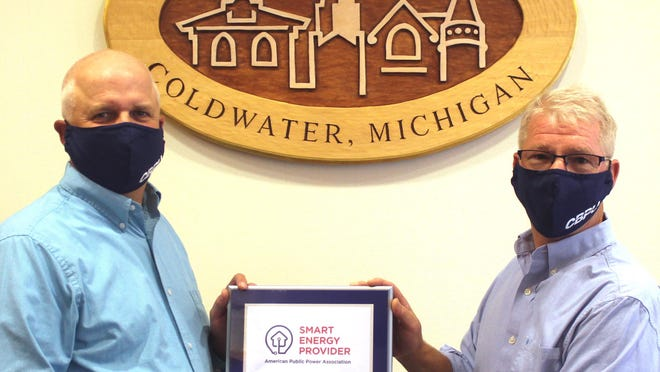 """Jeff Budd and Bob Granger recently accepted the """"Smart Energy Provider"""" designation on behalf of CBPS."""