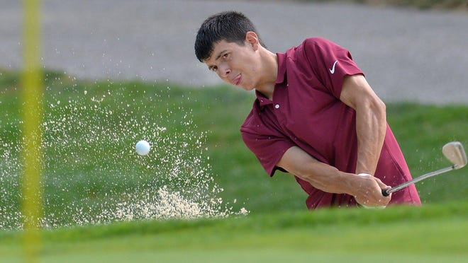 North East senior golfer Isaiah Swan hits a sand shot on hole No. 3 during a match with Mercyhurst Prep and McDowell at Lake View Country Club on Thursday. He was the medalist with a 2-under-par round of 70.  This was the first high school sporting event in Erie County since play was canceled in March due to the COVID-19 pandemic.