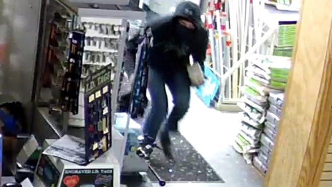 Surveillance footage from Baker's Hardware in Millsboro shows the suspect wanted for the stealing of 14 firearms. A $10,000 reward is being offered.