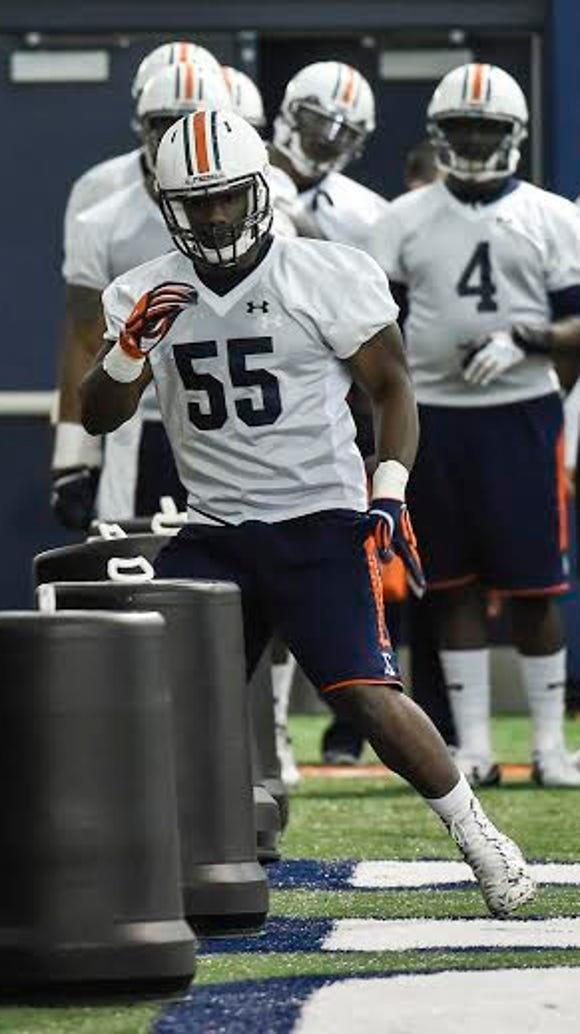 Auburn defensive end Carl Lawson (55) working drills