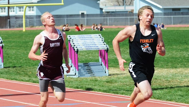 Fernley senior Devin Archer, right, has the edge over Dayton's Tobias Tapley, who was second. Archer won the two sprints on the YHS track last Saturday.