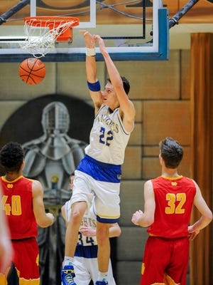 Castle's Jack Nunge (22) dunks the ball over Mater Dei's Sam Fulton (40) and Mater Dei's Ethan Dale (32) during the first round of the SIAC Tournament at Castle High School in Newburgh, Tuesday, Jan. 10. 2017. Castle beat Mater Dei 78-41.