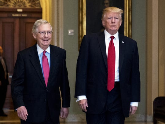 President Donald Trump, escorted by Senate Majority