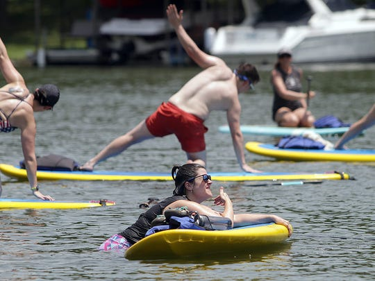 Kaitlyn Stokes gets back on her board after slipping off in Old Hickory Lake in Hendersonville.