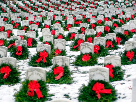 Arlington National Cemetery, shown with wreaths placed there at a past Wreaths Across America event. The national organization plans to place a wreath at all 230,000 gravesites there on Saturday.