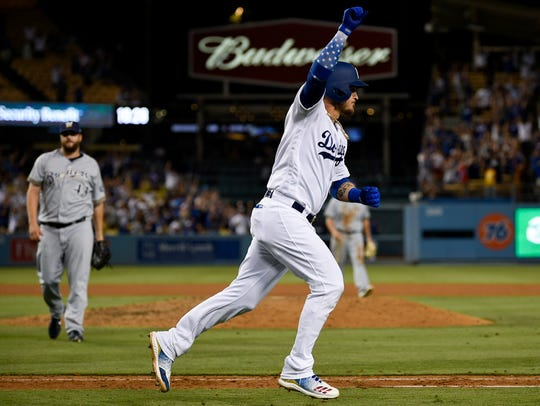 Yasmani Grandal of the Dodgers celebrates as he starts