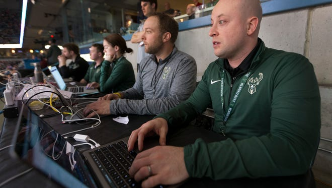 Milwaukee Bucks digital employees Matt Stanton (foreground) and Nick Monroe edit video highlights and tweet them during the game against the Houston Rockets March 7 at the BMO Harris Bradley Center in Milwauke.