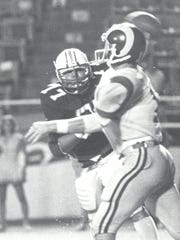 Ed Orgeron (77) chases down an opposing quarterback while playing defensive line for Northwestern State.