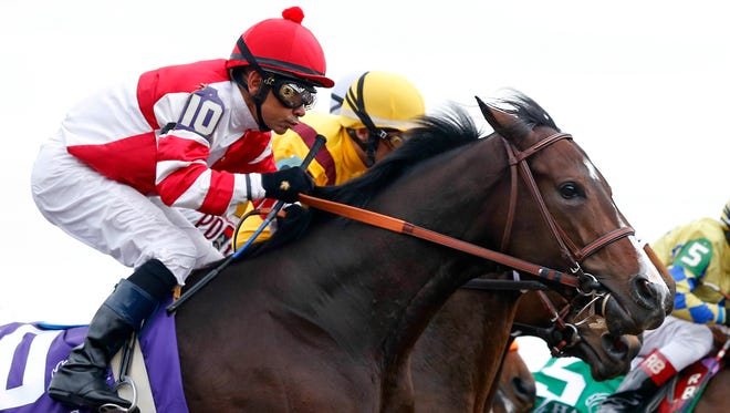 Songbird with jockey Mike Smith gets a good break from the gate during the Breeders' Cup Juvenile Fillies. Oct. 31, 2015