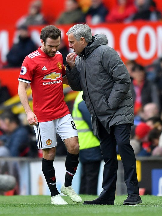 Manchester United manager Jose Mourinho, right, speaks to Juan Mata on the touchline during the Premier League soccer match at Old Trafford in Manchester, England, Saturday March 31, 2018.(Anthony Devlin/PA via AP)