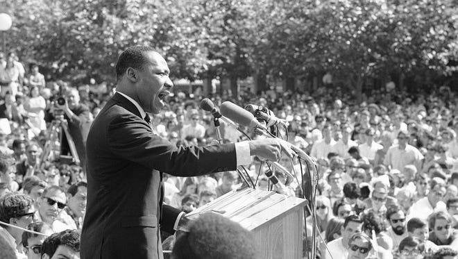"FILE - In this May 17, 1967 file photo, Dr. Martin Luther King speaks at the University of California administration building in Berkeley, Calif. Fifty years ago, Martin Luther King Jr. asked Americans, ""Where do we go from here?"" His warning of chaos or community squarely confronted racism, and marked a shift from his emphasis on nonviolence to a demand for full economic and political equality. Younger generations of black activists say they prefer the pointed, more forceful King to the Nobel Peace Prize-winning pacifist who preached love over hate.   (AP Photo, File)"