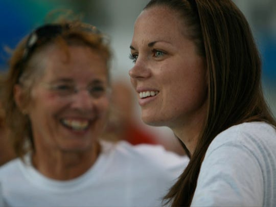 Katie Kennedy, right, has returned to coach swimming