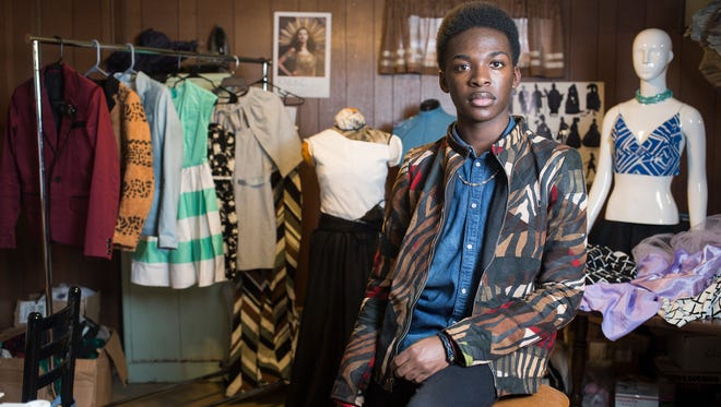 Sixteen year old clothing designer, Zach Lindsey, poses for a portrait in his basement studio.