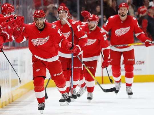 Red Wings left wing Andreas Athanasiou (72) celebrates his goal against the Avalanche in the second period on Sunday, Nov. 19, 2017, at Little Caesars Arena.