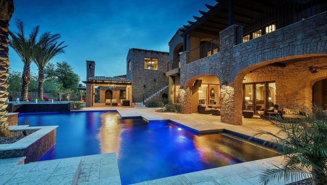 Jeffrey Darrow, president ofCertified Tire & Service Centers, and his wife, Paula, purchased this mansion in Chandler's Fulton Ranch Island community.