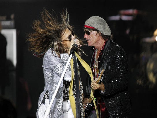 Steven Tyler (L) and Joe Perry, perfom on stage during