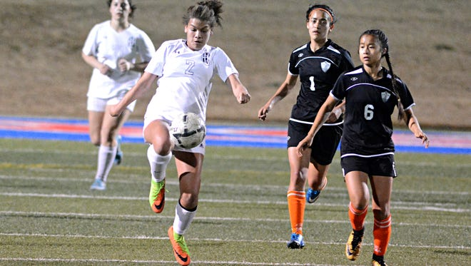 Abilene High Jocelyn Reece tries to control the ball in front of a pair of Haltom City Haltom players during the Lady Eagles 1-0 win Friday at Shotwell Stadium.