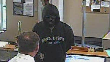 Police are searching for a man suspected of robbing the Union Savings Bank in Deer Park at gunpoint.