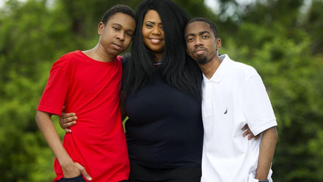 Kitty Lundan, wrote the song 'Now I Can't Breathe' for her sons Kobe Jarrett, 17, left, and Chadric Russell, 25.