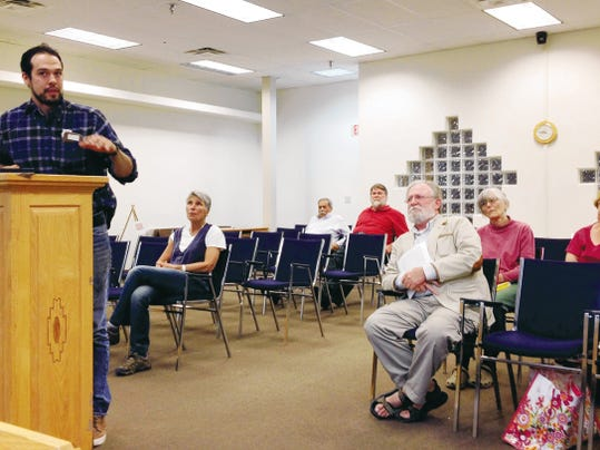 Anthony Quintana, owner of Q's Southern Bistro and Fry House, discusses a proposed grease barrel during Tuesday's Silver City Town Council meeting. Randal Seyler - Sun-News