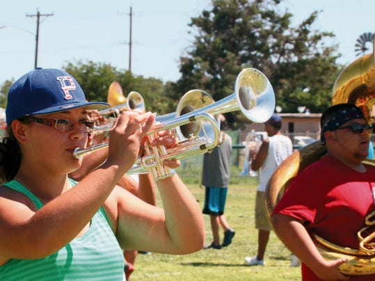 Kyleen Hensley marches during Wednesday's session of summer band camp at Deming High School.