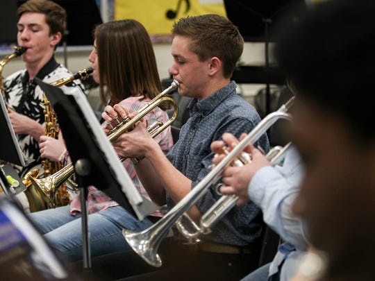 Kyle Butts, a senior, plays trumpet during Crescent High School band practice Tuesday at the school in Iva.