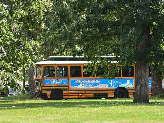St. Cloud Mayor Dave Kleis talks about the history of the city Friday, July 21, as they pass through St. Cloud State University on a 90-minute trolley tour around town.