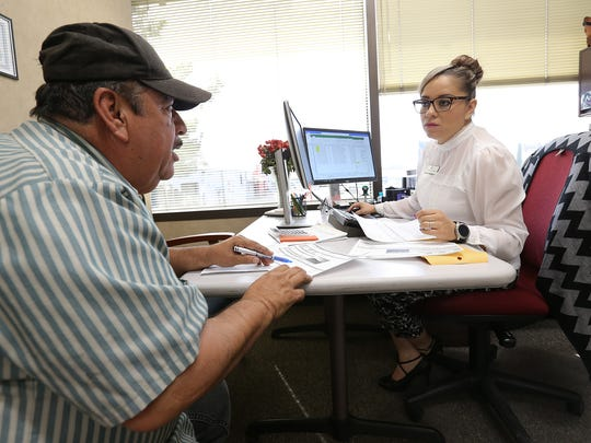 Mario Pargas talks with El Paso Central Appraisal District Senior Appraiser Esther Sanchez to try to have his home's valuation decreased.