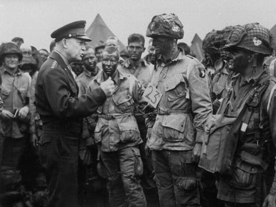 Gen. Dwight Eisenhower, left, gives a pep talk to U.S.