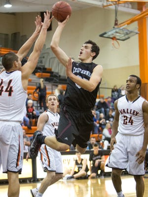 Ankeny Centennial's Jordan Brunkow (35) takes a shot over Valley's Quinton Curry (44) in the second quarter Tuesday.