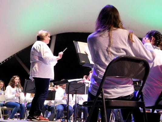 636461975741610187-Kelly-Behnke-band-director-at-Swift-Creek-leads-the-combined-bands.JPG