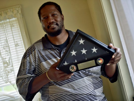 Dominique Brown, Chambersburg, holds a flag he received