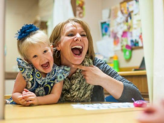Molly Beck plays games with Lucy Cronin as a fun way of improving her k and g sounds at the Scottish Rite Childhood Language Disorders Clinic. Scottish Rite offers free speech therapy services to area children.