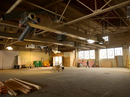 Workers from Immel Construction continue work on the