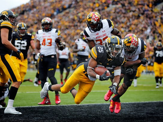 Iowa's Akrum Wadley dives for a touchdown during a