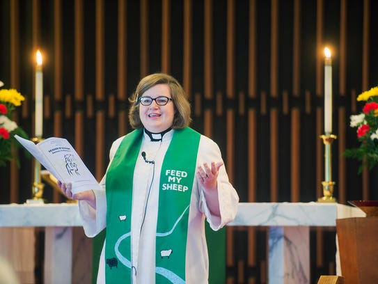 Pastor Laura Haupt reads the announcements at Luther