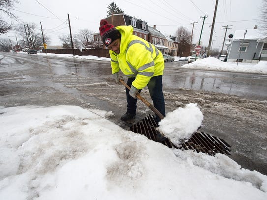 Eric Harris keeps storm drains clear for the runoff