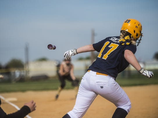Littlestown's McKenzie Somers tosses the bat as she