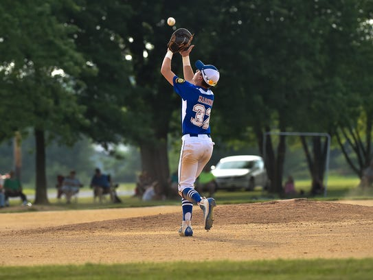 Shippensburg's Adam Maring catches a flyball during