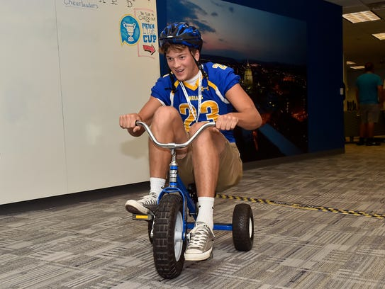 Waynesboro's Cameron Keck rides a tricycle around the