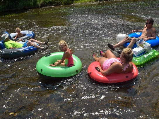 The Brennan family get situated to float down the Conococheague