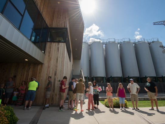 Visitors to Dogfish Head Brewery in Milton wait in