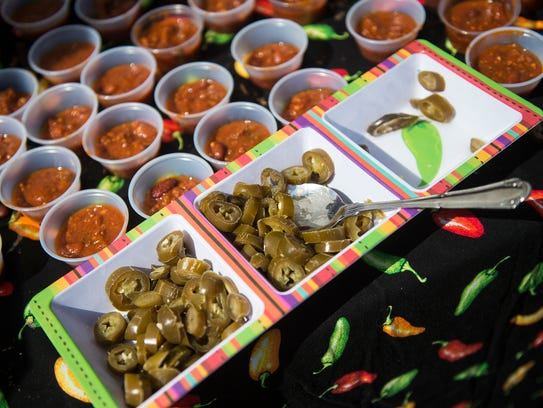 Chili samples and chopped jalapenos are set out for