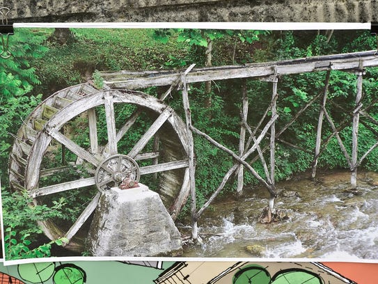 A photograph at the job site shows the old Water Wheel