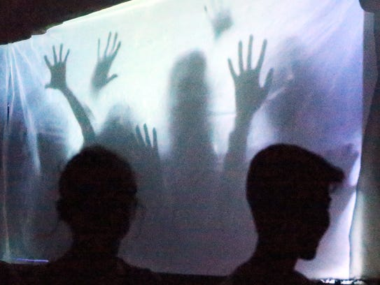 A screen featured zombies at the window at last year's