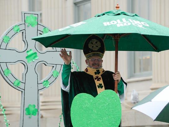 Patrick Kelly stays dry as Saint Patrick at the Irish