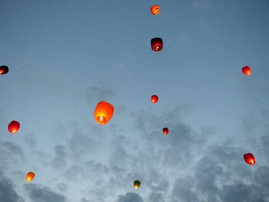 Friends and family released lanterns into the sky for