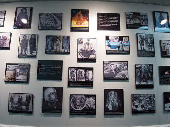 Photos on display of ILC Dover's history at their Frederica
