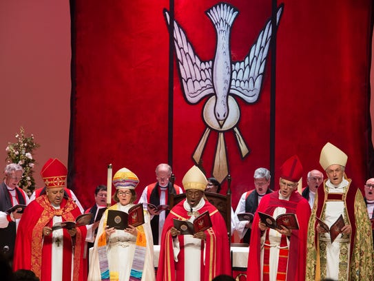 The Most Rev. Michael B. Curry, center, presiding bishop