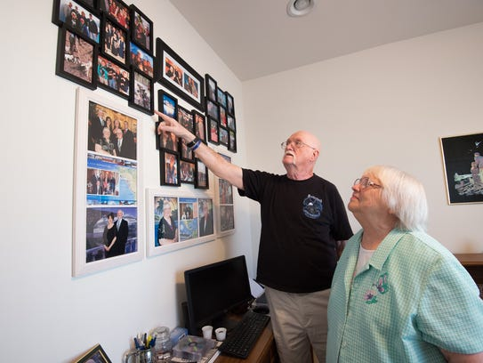 Virginia and Jack Cotterman look at photos from some of their family vacations over the years at their home in Camden. They chose Delaware because of the lower property taxes and because they wanted to be close to three children and grandkids living in Connecticut.